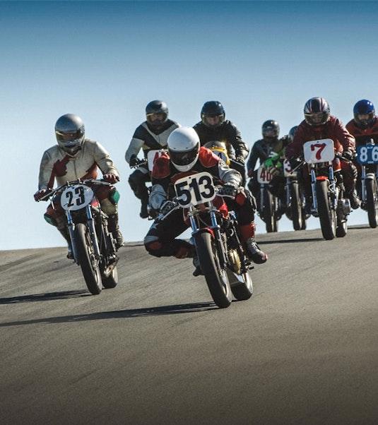 motorscyclists on motorcycles in a race