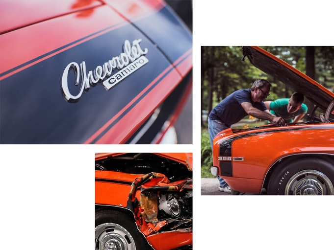A man and his son pop up the hood of an orange Chevrolet Camaro to inspect the damage.