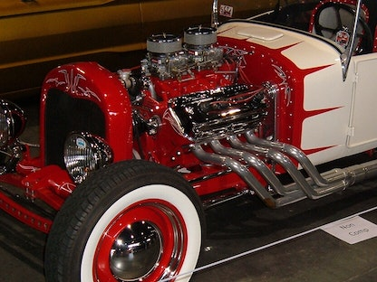 A red and white collector vehicle with an enhanced engine.