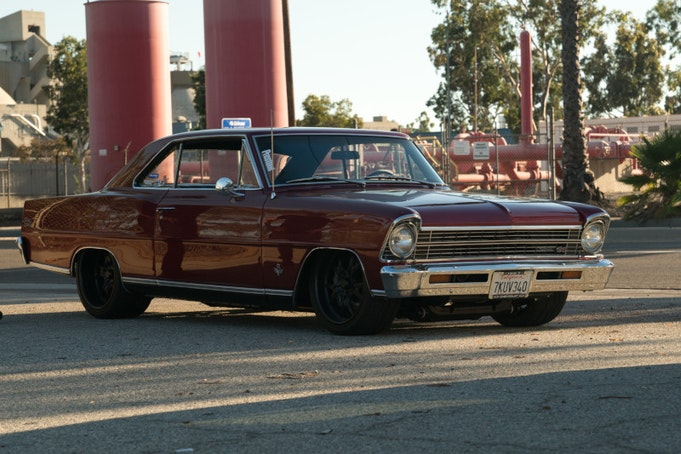 Classic Chevy Nova parked in industrial area