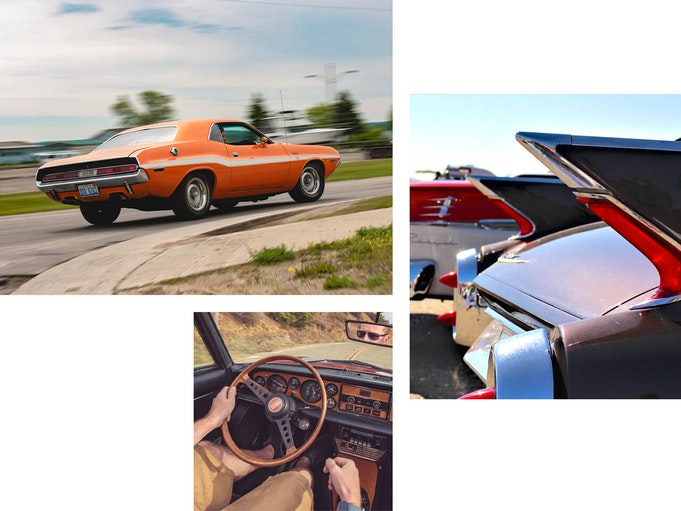 An orange collector vehicle driving down an open road. Back of a classic car. Image from passenger seat looking at person sitting in drivers seat holding steering wheel of classic car.