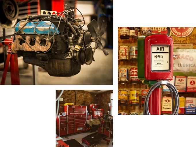 An engine, and air compressor, and storage cabinets sit inside of a garage.